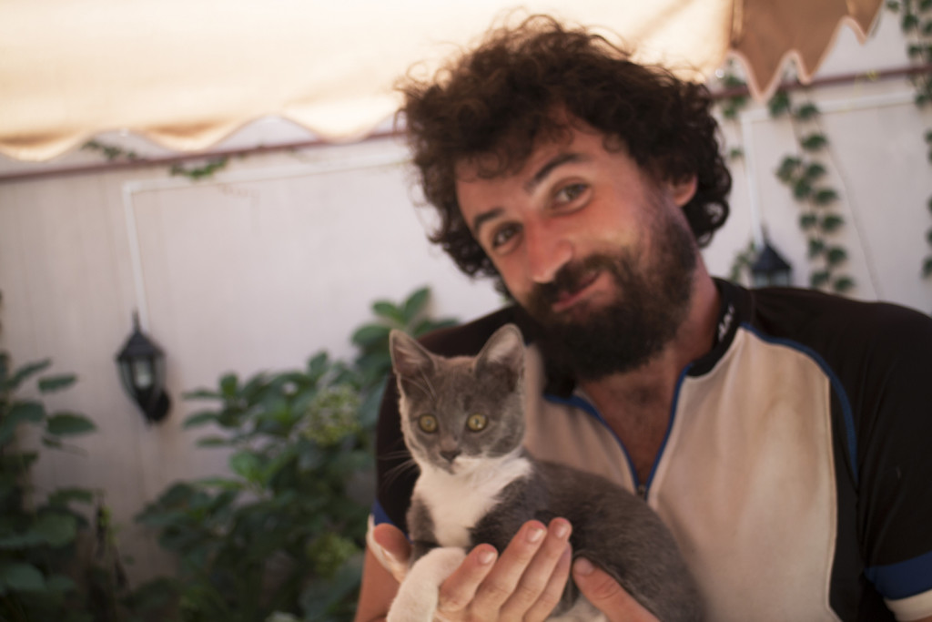 This is Adam and the hostel kitty.